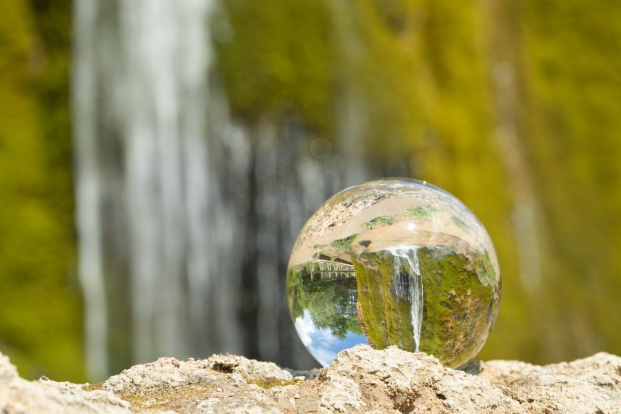 clear glass ball on brown rock